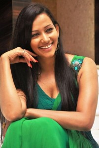 Sanjana Singh Hot Cleavage Show Pictures in Green Dress