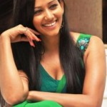 Sanjana Singh Cleavage Show Photos in Green Dress