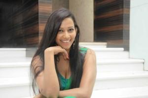Sanjana Singh Cleavage Show Photos in Green Dress